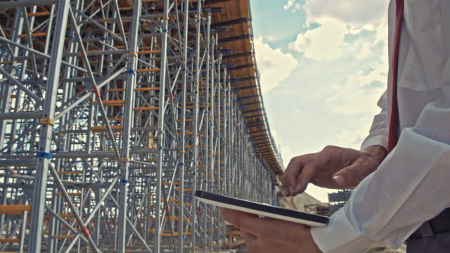 Engineer using a digital tablet at the construction site