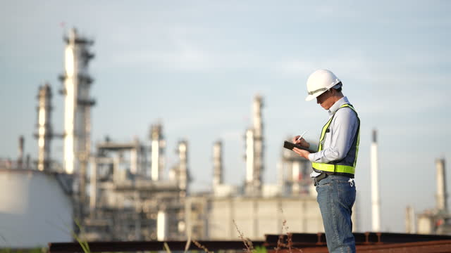 engineer using a tablet for checking the oil well functions - using digital tablet stock videos & royalty-free footage