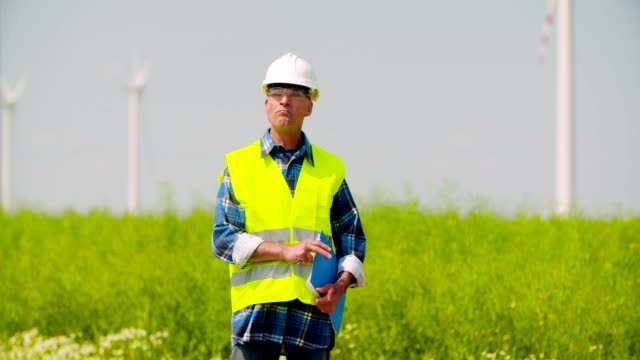 Engineer using digital tablet when doing Wind Turbine Inspection