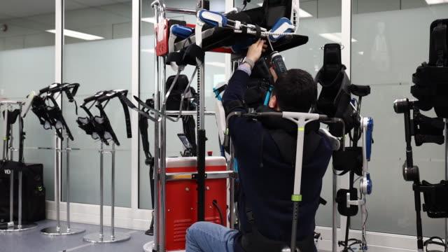 engineer using exoskeleton while working at hyundai motor group robotics laboratory in uiwang kyonggido province south korea on friday january 31 2020 - exoskeleton stock videos & royalty-free footage