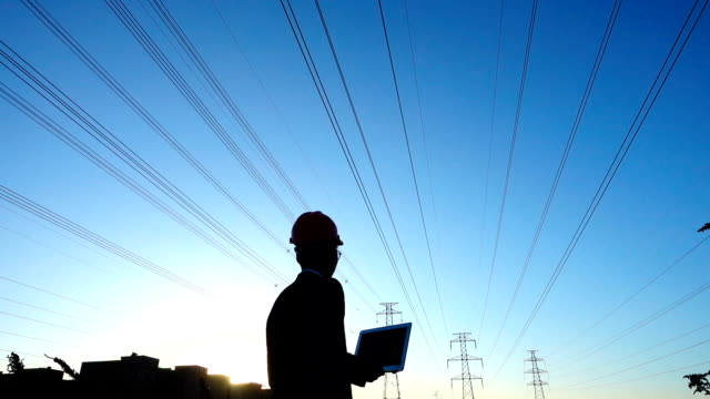 engineer using laptop at sunset - power supply stock videos & royalty-free footage