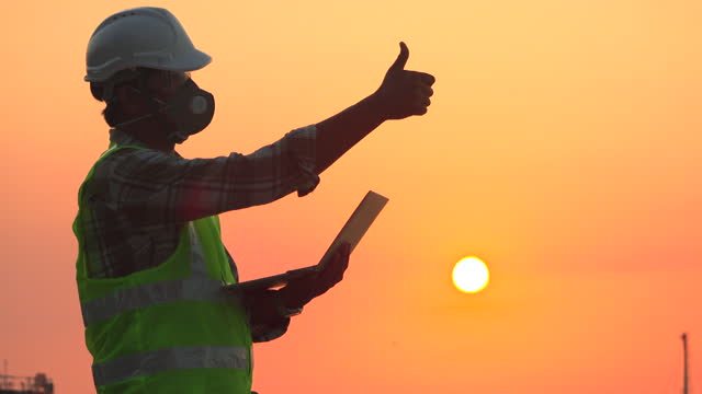 engineer using laptop or technology for inspect quality control with sunset background. construction industry or engineer concept. - quality control stock videos & royalty-free footage