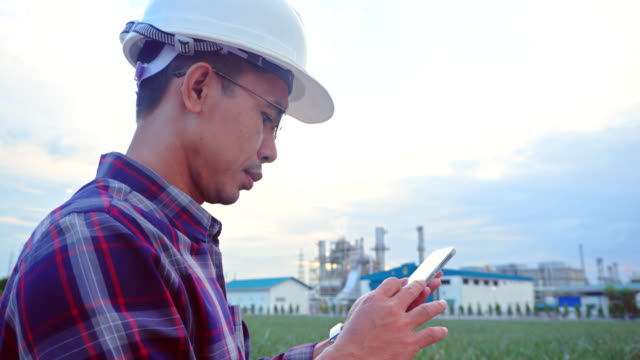 engineer using smartphone at industrial plant - platform shoe stock videos and b-roll footage