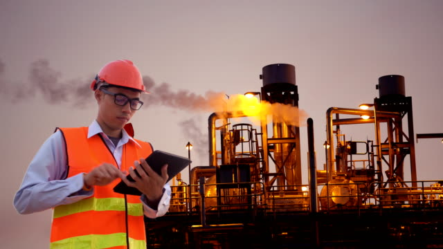engineer using tablet at industrial, oil or gas plant. - work helmet stock videos & royalty-free footage