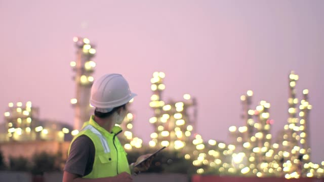 engineer with tablet at industrial oil or gas refinery background - coal stock videos & royalty-free footage