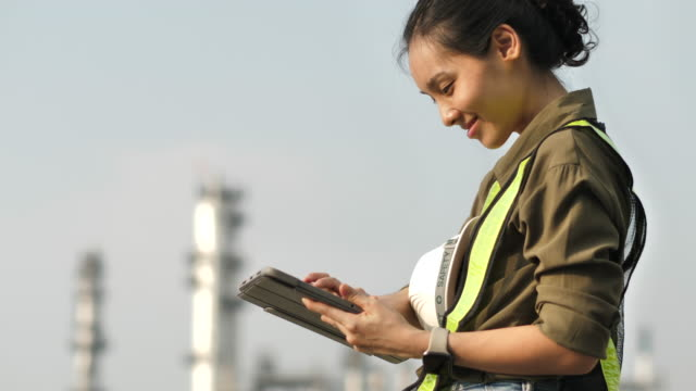 engineer woman working with digital tablet - females stock videos & royalty-free footage