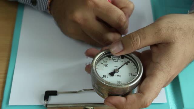Engineer work with pressure gauge