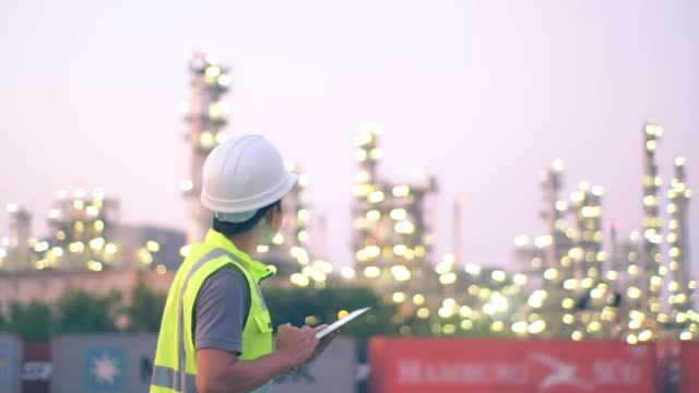 engineer worker at industrial plant working on a digital tablet, oil or gas plant. - improvement stock videos & royalty-free footage