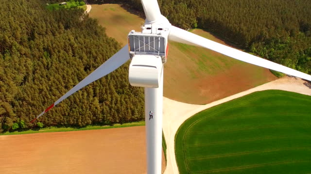 engineer worker to rappelling down on wind turbine - free falling stock videos & royalty-free footage