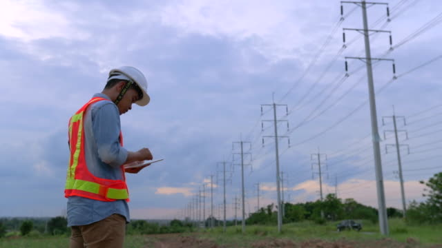 engineer workers, evaluation electrical energy, slow motion - electrician stock videos & royalty-free footage