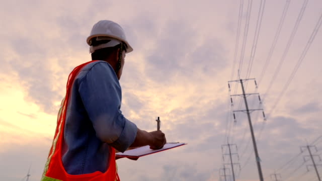 engineer workers, evaluation electrical energy - electricity pylon stock videos & royalty-free footage