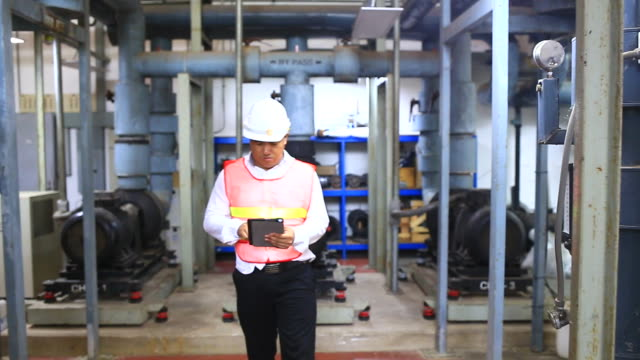 Engineer Working at Power Plant