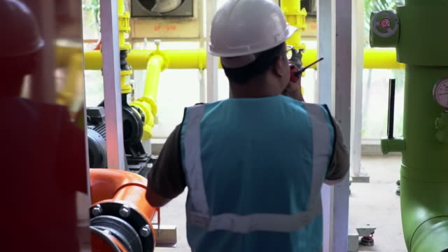 engineer working at power plant - gas pipe stock videos and b-roll footage