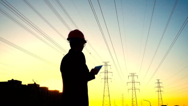 engineer working at sunset - power line stock videos & royalty-free footage