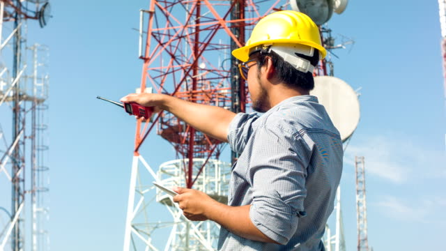 HD DOLLY : Engineer working at telecommunication tower site.