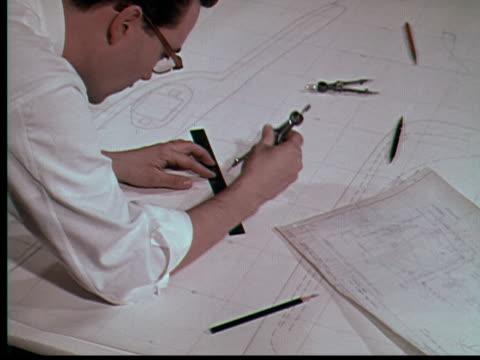 1955 CU Engineer working on drafting plans / USA