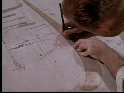1955 montage ms engineer working on drafting plans / usa - blueprint stock videos & royalty-free footage
