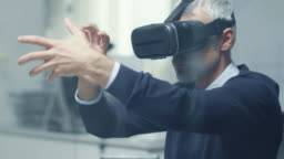 IT Engineer Working with Virtual Reality Headset On. He Works in His Modern and Minimalistic Office.