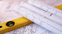 Engineering house drawings and blueprints, hard hat, building level and pencil