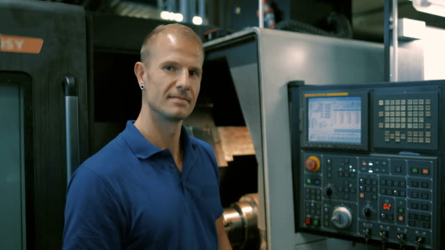 engineering in a modern german machine factory - polo shirt stock videos and b-roll footage