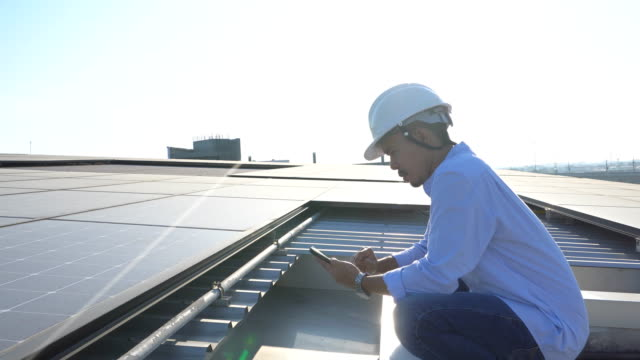 engineering inspect a solar panel - installing stock videos & royalty-free footage