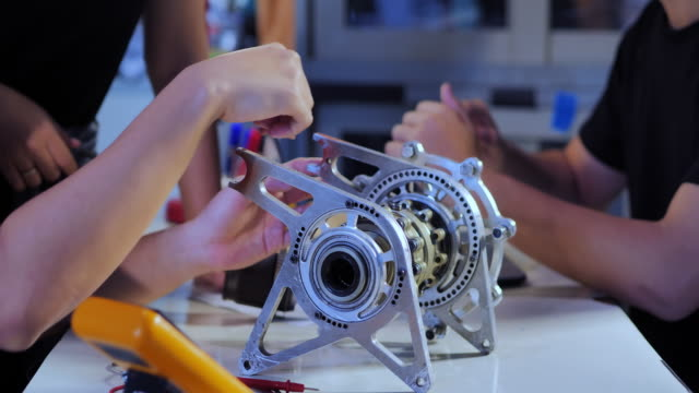 engineering students working in the laboratory.engineer/ technician working.they designing new component.education,technology,teamwork,science and people concept.education topics.young entrepreneurs at work - engineering stock videos & royalty-free footage