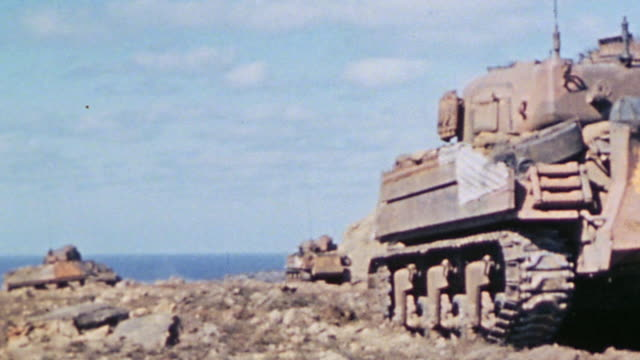 engineering tanks parked on ridge overlooking the pacific / iwo jima japan - schlacht um iwojima stock-videos und b-roll-filmmaterial