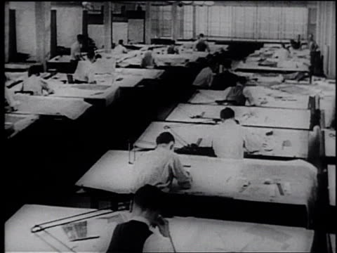 1945 montage engineers and draftsmen working at drawing tables / united states - frank capra video stock e b–roll