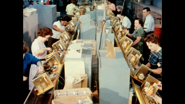 Engineers and mathematicians working together / production lines where parts are being assembled into antenna elements Bendix Corporations'...