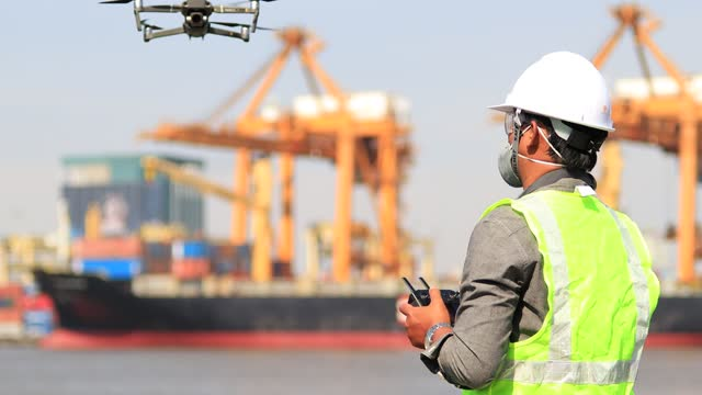 engineers are using drones to perform aerial inspections at work. useful technology in work - photograph stock videos & royalty-free footage