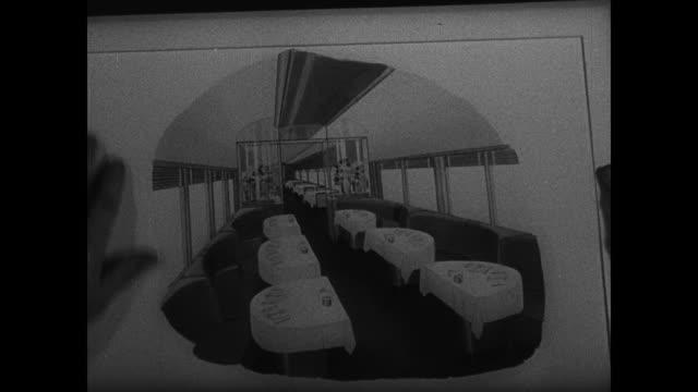 engineers building streamline train engine. int vs designers working on modern engine plans. men looking at plans. artist rendering of dining car.... - 1933 stock videos & royalty-free footage