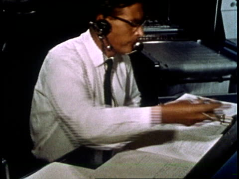 nasa engineers communicating in mission control center during gemini iv mission / houston texas united states - weltraum mission stock-videos und b-roll-filmmaterial