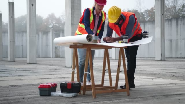 engineers consulting each other on construction site - girder stock videos & royalty-free footage