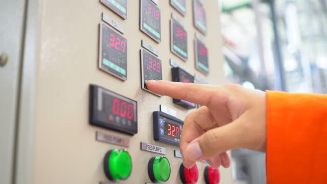 engineers examining machinery in control room - control stock videos & royalty-free footage