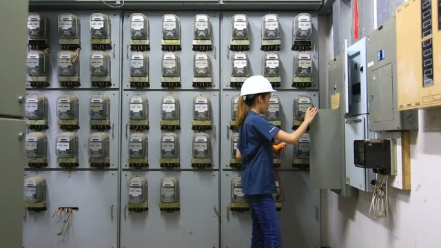 engineers examining machinery in control room. - control panel stock videos & royalty-free footage