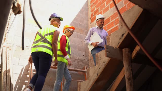engineers going up the stairs on a construction site - steps stock videos & royalty-free footage