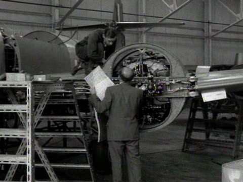 engineers look at the engine plans of a gloster meteor fighter jet - blueprint stock videos & royalty-free footage