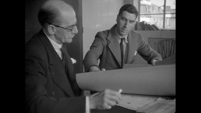 montage engineers looking at map to plan new telephone cable line in the chilterns / oxford, england, united kingdom - 1939 stock-videos und b-roll-filmmaterial