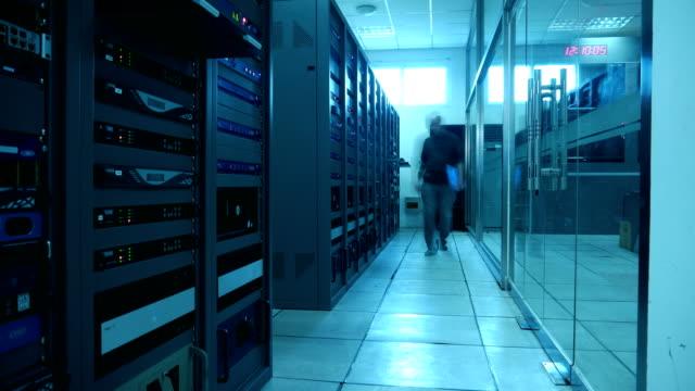 engineers maintain tv broadcasting machine room - examining stock videos & royalty-free footage