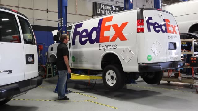 stockvideo's en b-roll-footage met engineers move a 350 volt battery pack to be installed in a federal express chevrolet express van at the via electric motors labs in orem utah on... - orem utah