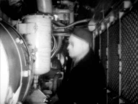 Engineers on around Union Pacific Railroad gas turbine locomotive train INT male checking engines train moving slowly w/ engineers on top train...