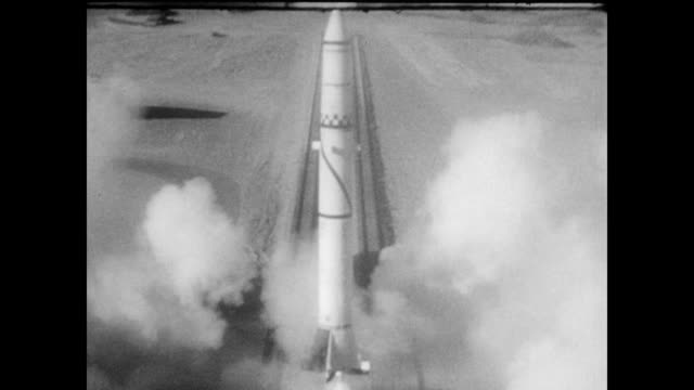 / engineers place camera on missile / missile launched into the air / view of missile falling to earth / stills of satellite pictures missile testing... - 1960 stock videos & royalty-free footage