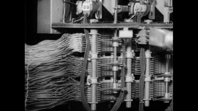 MONTAGE Engineers testing switches at a telephone exchange / London, England, United Kingdom
