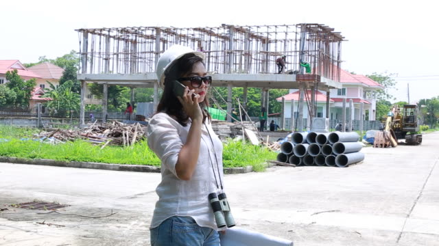 engineers woman on construction site with plan