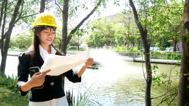engineers woman on construction site with plan - construction machinery stock videos and b-roll footage