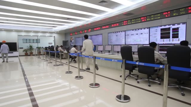 engineers work in a control room at the sahiwal coal power plant owned by china's state owned huaneng shandong rui group in sahiwal punjab pakistan... - punjab pakistan stock videos and b-roll footage