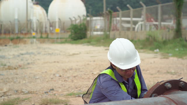 engineers workers outdoor are checking the gas system of the factory - examining stock videos & royalty-free footage
