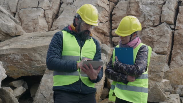 engineers working on a stone quarry. - industria mineraria video stock e b–roll
