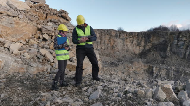 engineers working on a stone quarry. - stone material stock videos & royalty-free footage