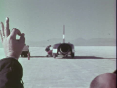 engineers working on jet propelled car on salt flats / spirit of america sonic i being lined up for attempt to break the land speed record / spirit... - bonneville salt flats stock videos and b-roll footage